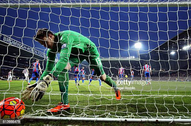 Wayne Hennessey of Crystal Palace picks up the ball from the back of the net after West Bromwich Albion's second goal during the Barclays Premier...