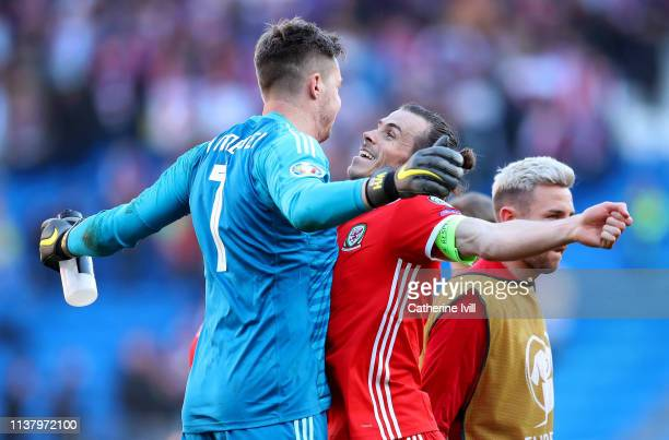 Wayne Hennessey of Wales celebrates with Gareth Bale of Wales after their team win the 2020 UEFA European Championships group E qualifying match...