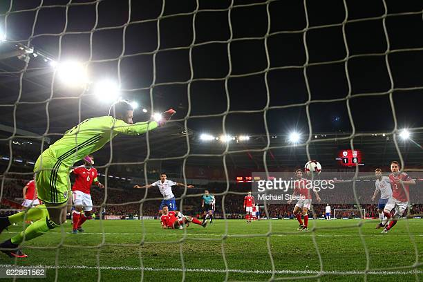 Wayne Hennessey of Wales is unable to stop Aleksandar Mitrovic of Serbia scoring his team's first goal during the FIFA 2018 World Cup Qualifier...
