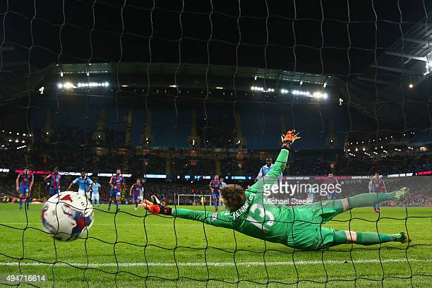 Wayne Hennessey the goalkeeper of Crystal Palace is beaten by a penalty from Yaya Toure of Manchester City conceding his sides fourth goal during the...