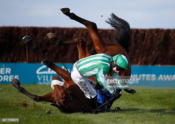 Wayne Hutchinson falls from Shantou Village at Wincanton Racecourse on November 5 2016 in Wincanton England