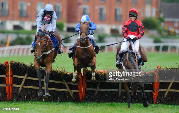 Wayne Hutchinson riding Fighter Jet clears the last to win the Reginald Corbet Novices' Hurdle Race at StratforduponAvon racecourse on August 29 2013...
