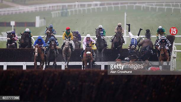 Wayne Hutchinson riding Midnight Prayer is unseated as the loose horse Le Reve runs across the front of the fence on the takeoff side in The...