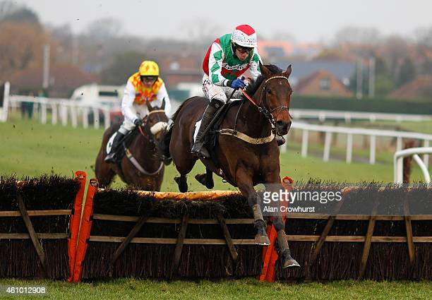Wayne Hutchinson riding Pain Au Chocolat clear the last to win The Compare Prices At attheracescom/odds Novices' Hurdle Race at Plumpton racecourse...