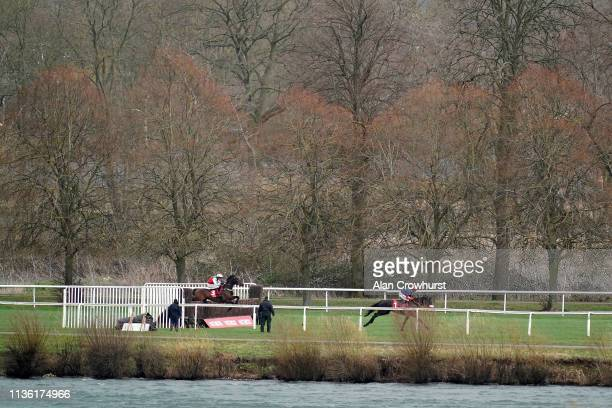Wayne Hutchinson riding Timoteo sit in second position before going on to win The Get Switched On With Matchbook Chase at Kempton Park on March 16...