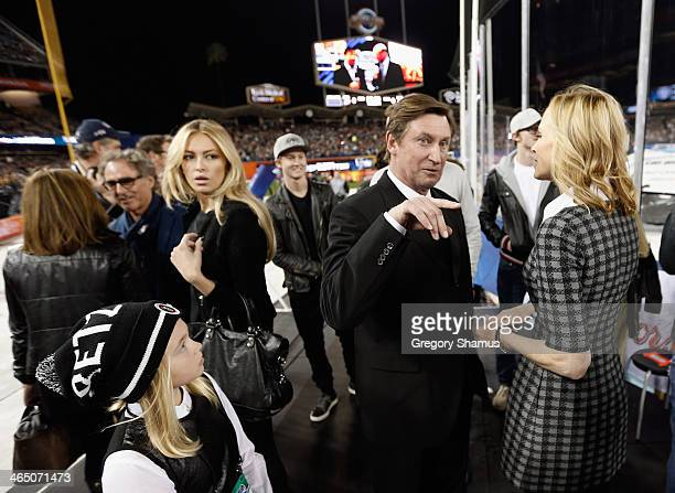 Wayne Janet Paulina and Emma Gretzky attend the 2014 Coors Light NHL Stadium Series between the Los Angeles Kings and the Anaheim Ducks at Dodger...