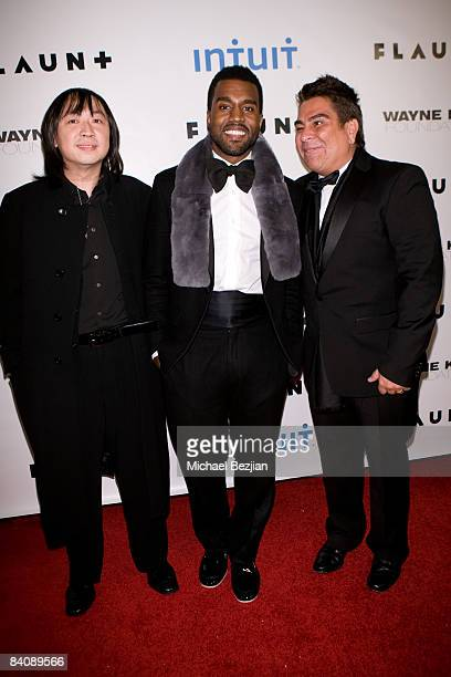 Wayne Kao, Kanye West and Flaunt Magazine Publisher Louis Barajas arrive at Flaunt Magazine's 10th Anniversary Party and Annual Holiday Toy Drive at...