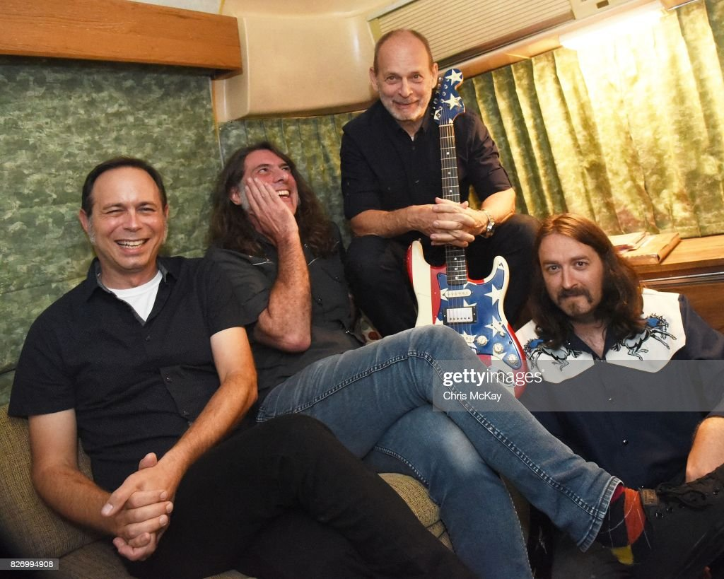 Wayne Kramer (third from left) and his band members Adam Renshaw, Shannon Mulvaney, and Adam McIntyre wait backstage to perform during the Artist2Artist benefit for Homeless Veterans at The Office on August 5, 2017 in Athens, Georgia.