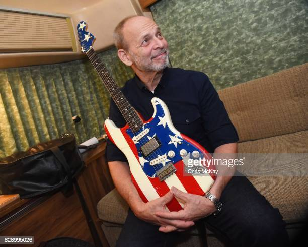 Wayne Kramer waits backstage with his famous American Flag Fender Stratocaster for his performance at the Artist2Artist Benefit For Homeless Veterans...