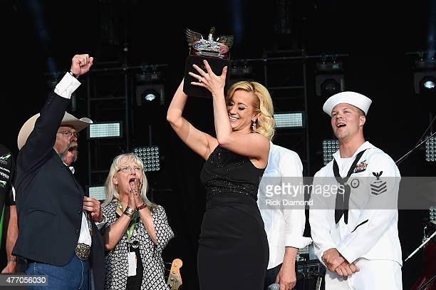 Wayne Kyle and Deby Kyle parents of United States Navy SEAL sniper Chris Kyle speak onstage with singer Kellie Pickler during the 2015 CMA Festival...