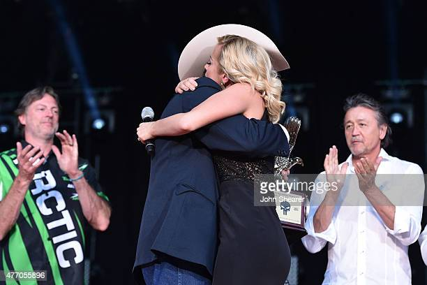 Wayne Kyle father of United States Navy SEAL sniper Chris Kyle onstage with singer Kellie Pickler during the 2015 CMA Festival on June 13 2015 in...
