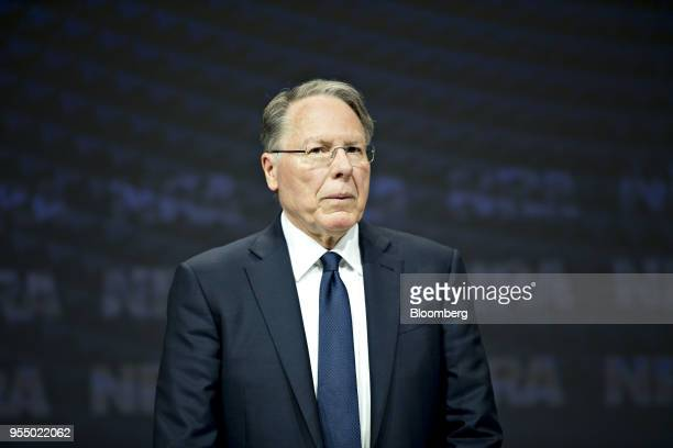 Wayne LaPierre chief executive officer of the National Rifle Association stands on stage after arriving for the meeting of members at the NRA annual...