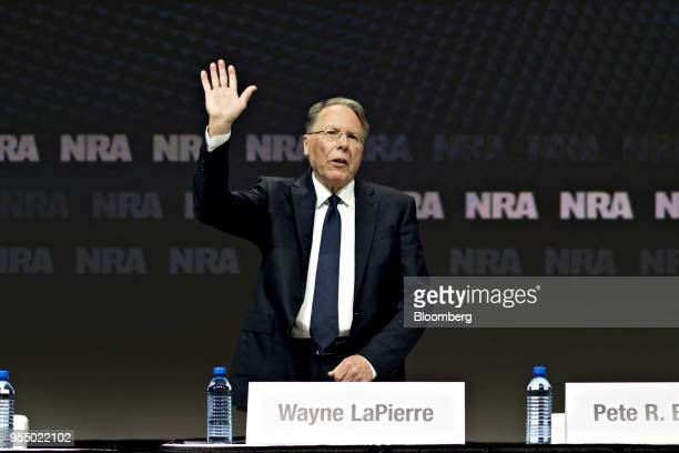 Wayne LaPierre chief executive officer of the National Rifle Association waves to the crowd after arriving for the meeting of members at the NRA...