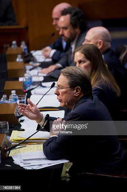 Wayne LaPierre foreground executive vice president and CEO of the National Rifle Association testifies before a Senate Judiciary Committee hearing in...