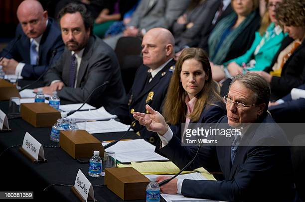 Wayne LaPierre right executive vice president and CEO of the National Rifle Association testifies before a Senate Judiciary Committee hearing in Hart...
