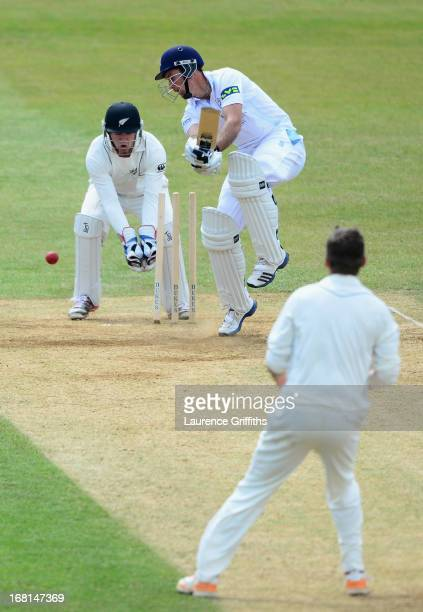 Wayne Madsen of Derbyshire is bowled by Bruce Martin of New Zealand during the Tour match between Derbyshire and New Zealand at The County Ground on...