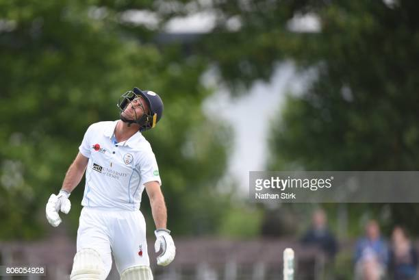Wayne Madsen of Derbyshire looks on in pain after being hit by the ball during the Specsavers County Championship Division Two match between...