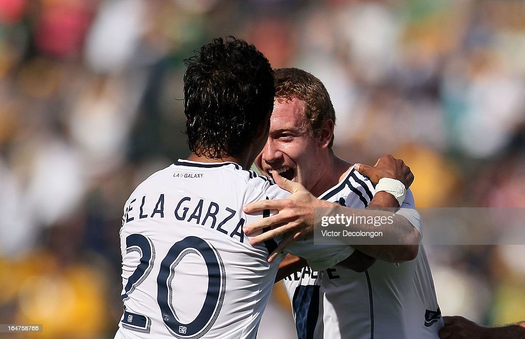 Wayne McBean #32 of the Los Angeles Galaxy celebrates his goal with A.J. DeLaGarza #20 during the MLS match against Chivas USA at The Home Depot Center on March 17, 2013 in Carson, California. Chivas USA and the Los Angeles Galaxy played to a 1-1 draw.