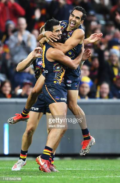 Wayne Milera of the Adelaide Crows celebrates a goal with Eddie Betts of the Adelaide Crows during the round 10 AFL match between the Adelaide Crows...