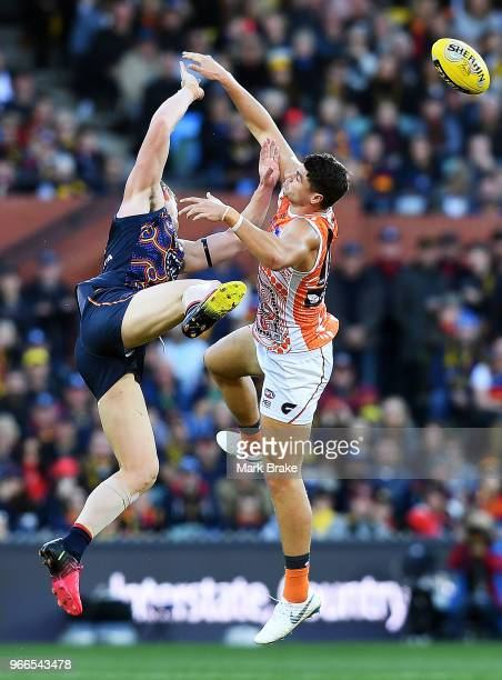 Wayne Milera of the Adelaide Crows collides heavily with Heath Shaw of the Giants during the round 11 AFL match between the Adelaide Crows and the...
