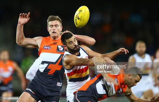Wayne Milera of the Crows and Adam Tomlinson of the Giants contest possession during the round 21 AFL match between the Greater Western Giants and...