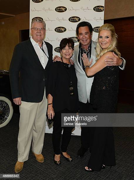Wayne Newton and his wife Kathleen McCrone Newton pose with guests at the VIP opening of Casa De Shenandoah on September 17 2015 in Las Vegas Nevada