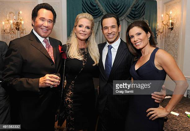 Wayne Newton Kathleen McCrone Helio Castroneves and Adriana Henao attend the 30th Annual Great Sports Legends Dinner to benefit The Buoniconti Fund...