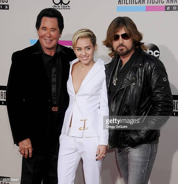 Wayne Newton Miley Cyrus and Billy Ray Cyrus arrive at the 2013 American Music Awards at Nokia Theatre LA Live on November 24 2013 in Los Angeles...