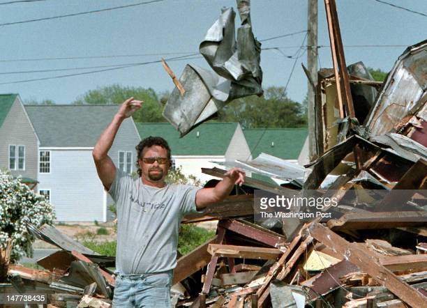 FILE Wayne Norton works to separate the tin from the wood on the torndown Collins family residence in Bayview Virginia on May 1 2003 New Bayview...