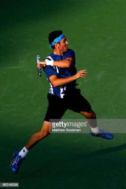 Wayne Odesnik returns a shot to John Isner during the Indianapolis Tennis Championships on July 24 2009 at the Indianapolis Tennis Center in...
