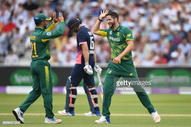 Wayne Parnell of South Africa celebrates with JP Duminy after dismissing David Willey of England during the 3rd Royal London ODI between England and...