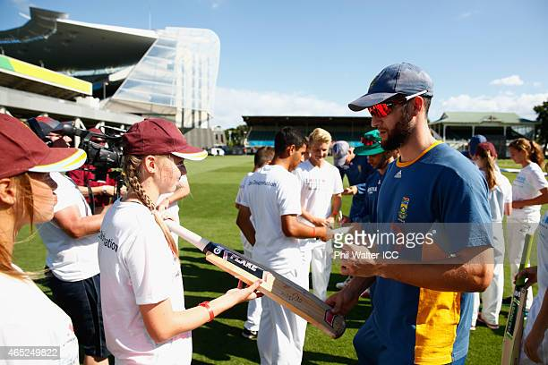 Wayne Parnell of South Africa signs a bat uring a Charity Training and Coaching Session at Eden Park 2 on March 5 2015 in Auckland New Zealand