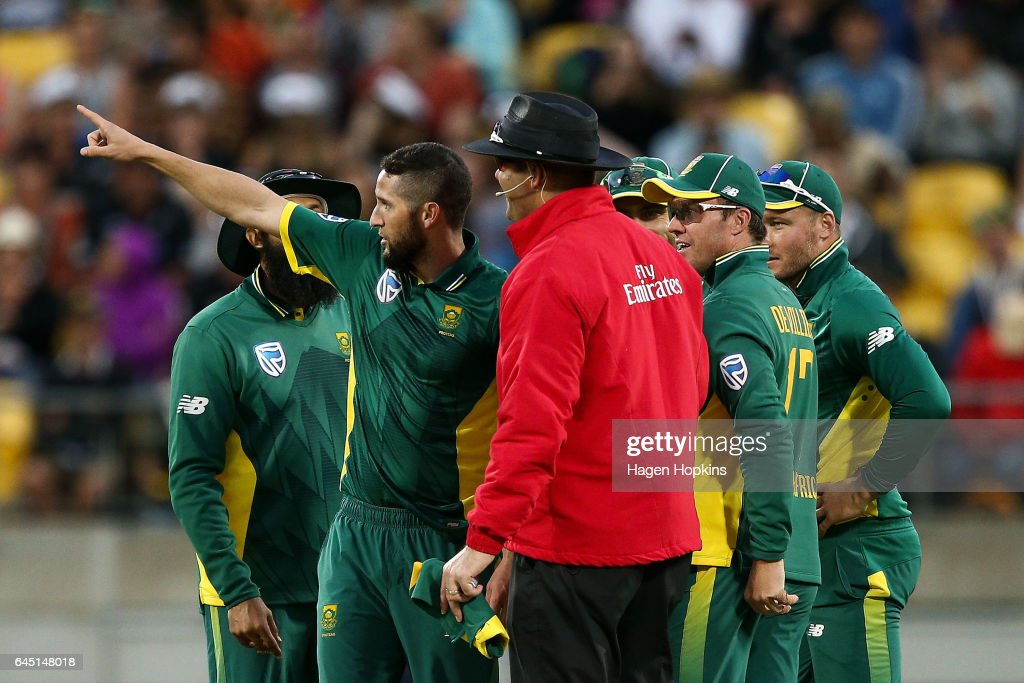 Wayne Parnell of South Africa talks to umpire Chris Brown of New Zealand after dismissing Jimmy Neesham of New Zealand during game three of the One Day International series between New Zealand and South Africa at Westpac Stadium on February 25, 2017 in Wellington, New Zealand.