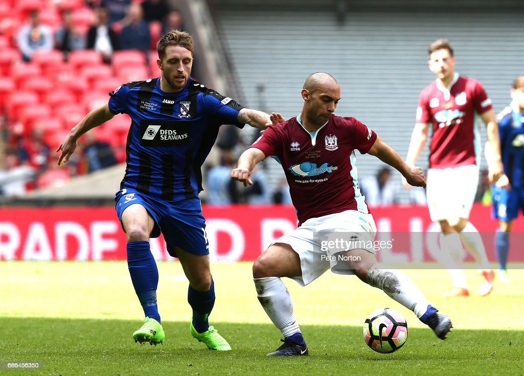 Wayne Phillips of South Shields plays the ball under pressure from Jack Richardson of Cleethorpes Town during The Buildbase FA Vase Final between South Shields and Cleethorpes Town at Wembley Stadium on May 21, 2017 in London, England.