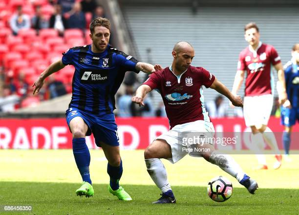 Wayne Phillips of South Shields plays the ball under pressure from Jack Richardson of Cleethorpes Town during The Buildbase FA Vase Final between...