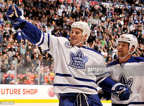 Wayne Primeau and Colton Orr of the Toronto Maple Leafs celebrate a first period goal against the Detroit Red Wings during game action November 7...