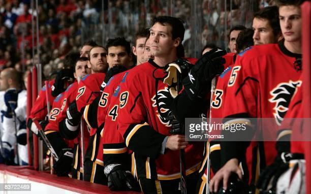 Wayne Primeau and teammates of the Calgary Flames stand on the bench during the pre game ceremony against the Toronto Maple Leafs on November 11 2008...