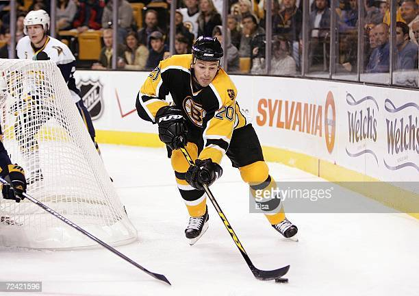 Wayne Primeau of the Boston Bruins reaches for the puck behind the net against the Buffalo Sabres on November 2 2006 at TD Banknorth Garden in Boston...