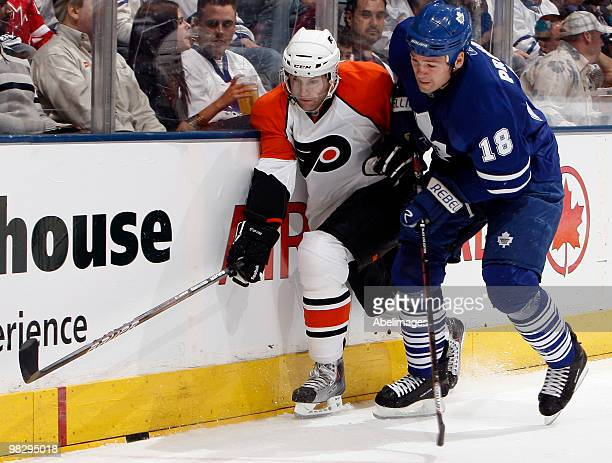 Wayne Primeau of the Toronto Maple Leafs runs into Ryan Parent of the Philadelphia Flyers during an NHL game at the Air Canada Centre April 6 2010 in...