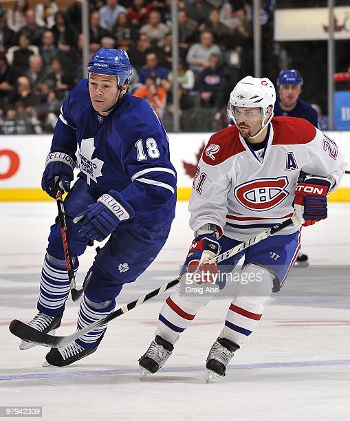 Wayne Primeau of the Toronto Maple Leafs skates with Brian Gionta of the Montreal Canadiens during the game on March 20 2010 at the Air Canada Centre...