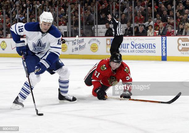 Wayne Primeau of the Toronto Maple Leafs takes the puck up the ice as Brian Campbell of the Chicago Blackhawks slips while chasing after on November...