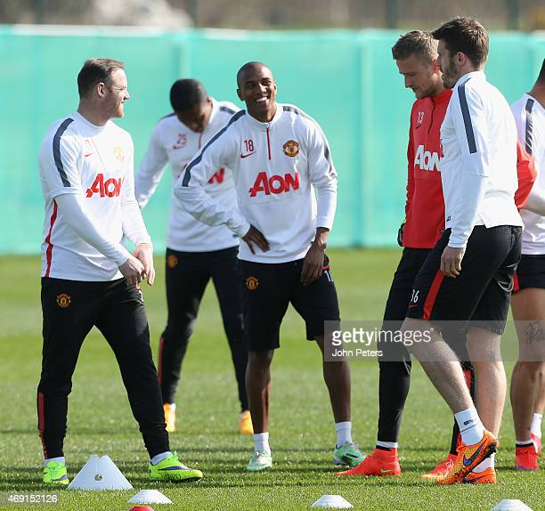 Wayne Rooney ancd Ashley Young of Manchester United in action during a first team training session at Aon Training Complex on April 10 2015 in...