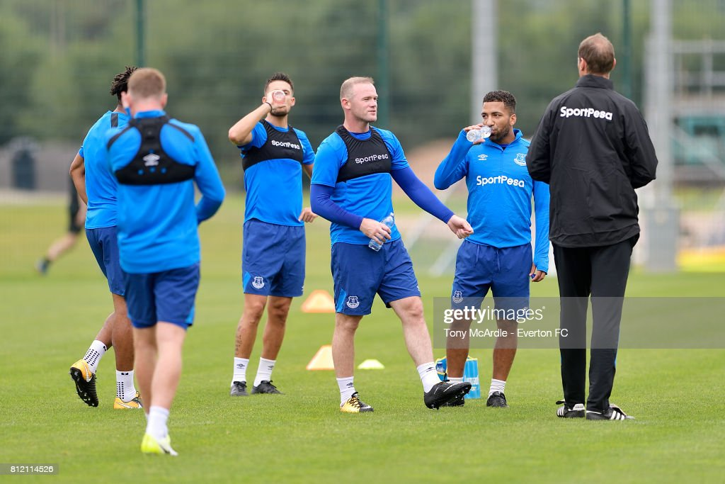Wayne Rooney (C) and Aaron Lennon (R) during the Everton training session at USM Finch Farm on July 10, 2017 in Halewood, England.