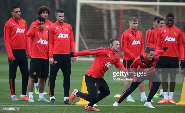 Wayne Rooney and Adnan Januzaj of Manchester United in action during a first team training session at Aon Training Complex on November 21 2014 in...