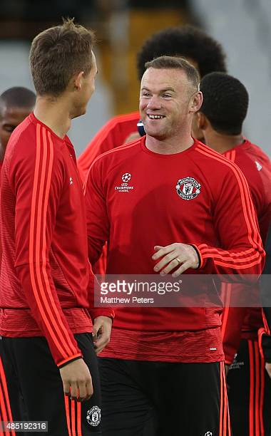 Wayne Rooney and Adnan Januzaj of Manchester United in action during a first team training session ahead of their UEFA Champions League playoff...