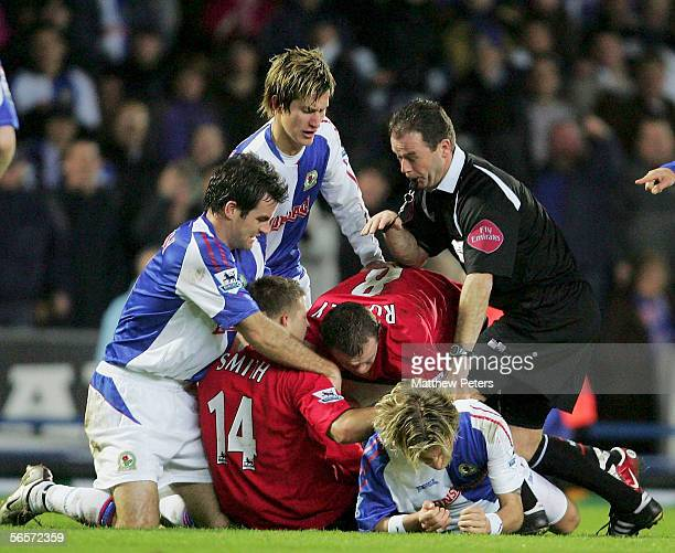 Wayne Rooney and Alan Smith of Manchester United clash with Robbie Savage of Blackburn Rovers during the Carling Cup semi final first leg match...