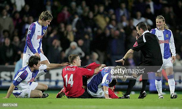 Wayne Rooney and Alan Smith of Manchester United clash with Robbie Savage of Blackburn Rovers during the Carling Cup semifinal first leg match...