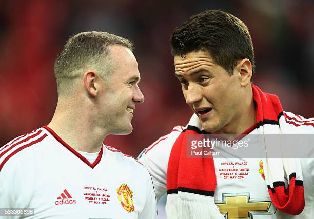 Wayne Rooney and Ander Herrera of Manchester United in discussion after winning The Emirates FA Cup Final match between Manchester United and Crystal...