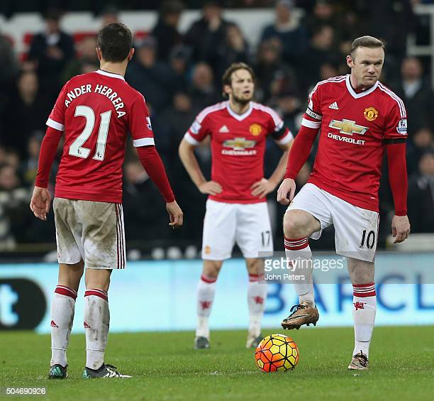 Wayne Rooney and Ander Herrera of Manchester United react to conceding a goal to Aleksandar Mitrovic during the Barclays Premier League match between...