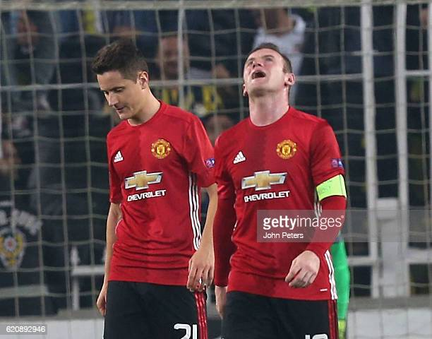 Wayne Rooney and Ander Herrera of Manchester United react to conceding a goal to Jermaine Lens of Fenerbahce during the UEFA Europa League match...